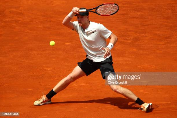 Kyle Edmund of Great Britain in action against Novak Djokovic of Serbia in their second round match during day five of the Mutua Madrid Open at La...
