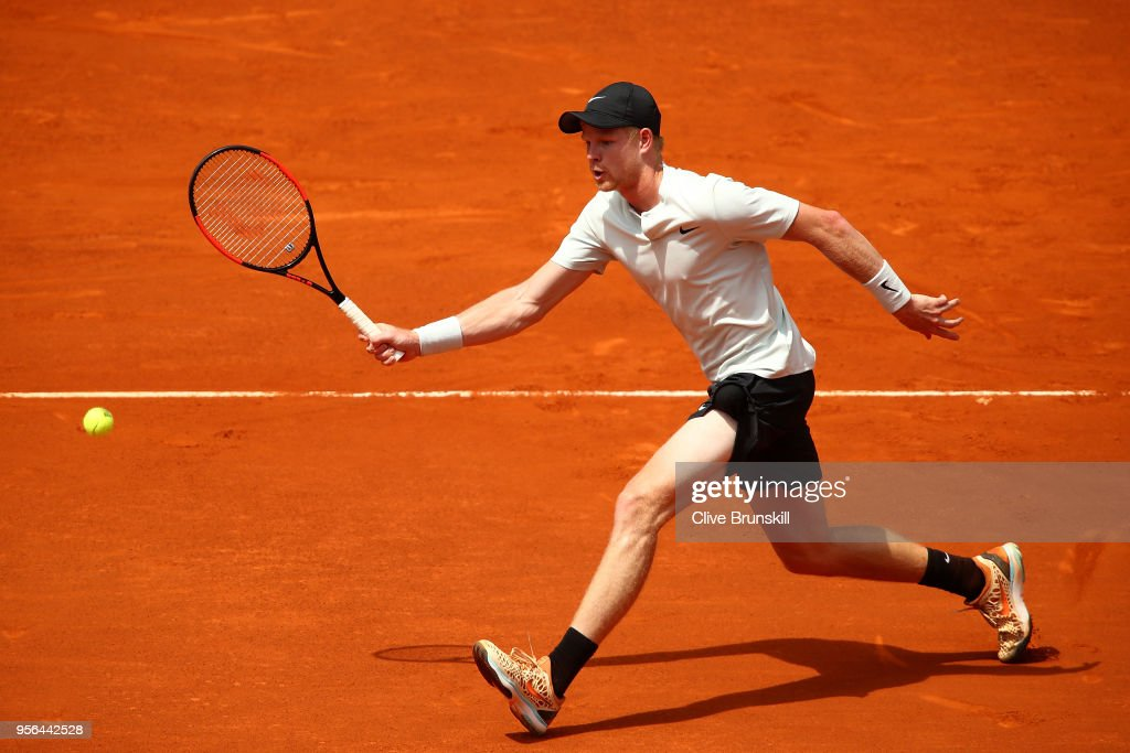Kyle Edmund of Great Britain in action against Novak Djokovic of Serbia in their second round match during day five of the Mutua Madrid Open at La Caja Magica on May 9, 2018 in Madrid, Spain.