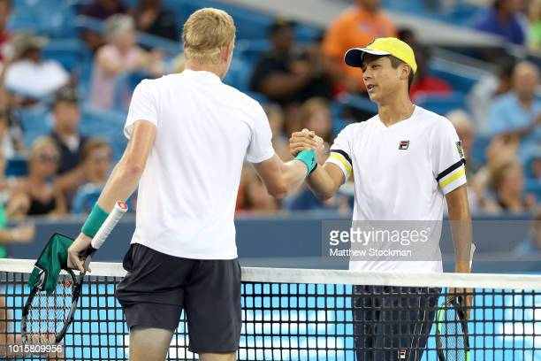 Kyle Edmund of Great Britain is congratuated by MacKenzie McDonald during the Western Southern Open at Lindner Family Tennis Center on August 12 2018...
