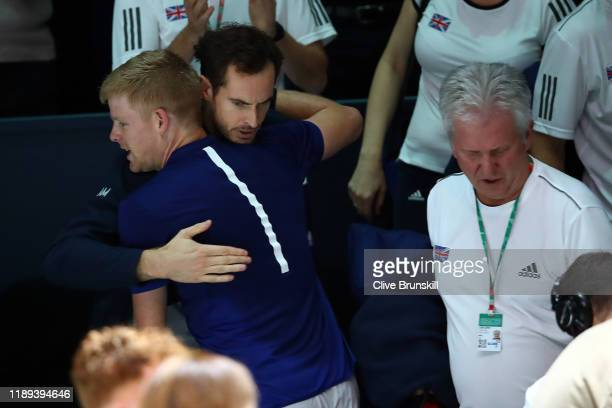 Kyle Edmund of Great Britain is congratulated by Andy Murray after winning match point during his quarter final match against Philipp Kohlschreiber...