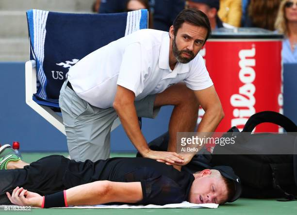 Kyle Edmund of Great Britain is treated by the trainer during his third round match against Denis Shapovalov of Canada on Day Five of the 2017 US...
