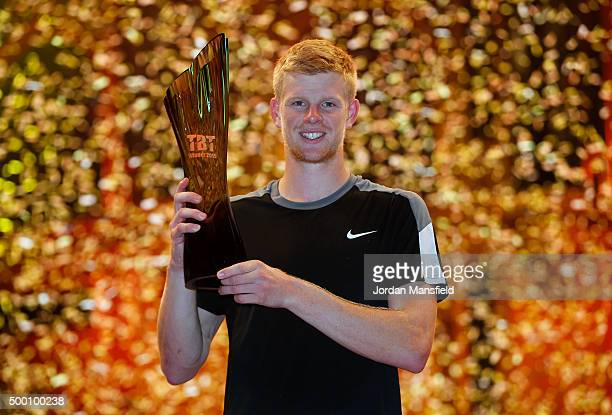 Kyle Edmund of Great Britain lifts the trophy after winning his Tie Break Tens singles match against Andy Murray of Great Britain during day four of...