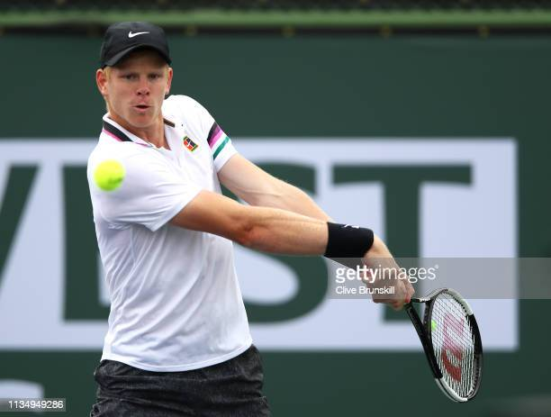 Kyle Edmund of Great Britain plays a backhand against Nicolas Jarry of Chile during their men's singles second round match on day seven of the BNP...