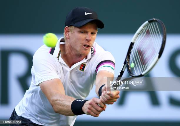 Kyle Edmund of Great Britain plays a backhand against Radu Albot of Moldova during their men's singles third round match on day nine of the BNP...