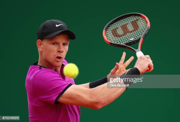 Kyle Edmund of Great Britain plays a backhand against Rafael Nadal of Spain in his second round match on day four of the Monte Carlo Rolex Masters at...