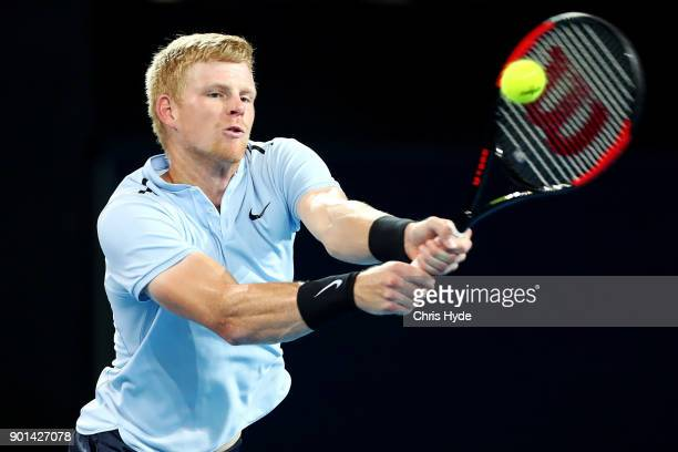 Kyle Edmund of Great Britain plays a backhand in his match against Grigor Dimitrovof of Bulgaria during day six of the 2018 Brisbane International at...