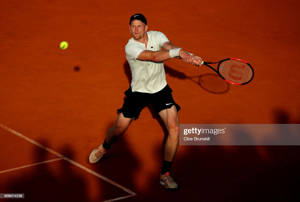 Kyle Edmund of Great Britain plays a backhand in his match against Daniil Medvedev of Russia during day four of the Mutua Madrid Open tennis tournament at the Caja Magica on May 8, 2018 in Madrid, Spain.