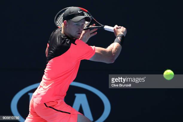 Kyle Edmund of Great Britain plays a backhand in his second round match against Denis Istomin of Uzbekistan on day three of the 2018 Australian Open...