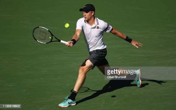 Kyle Edmund of Great Britain plays a forehand against Roger Federer of Switzerland during their men's singles fourth round match on day ten of the...