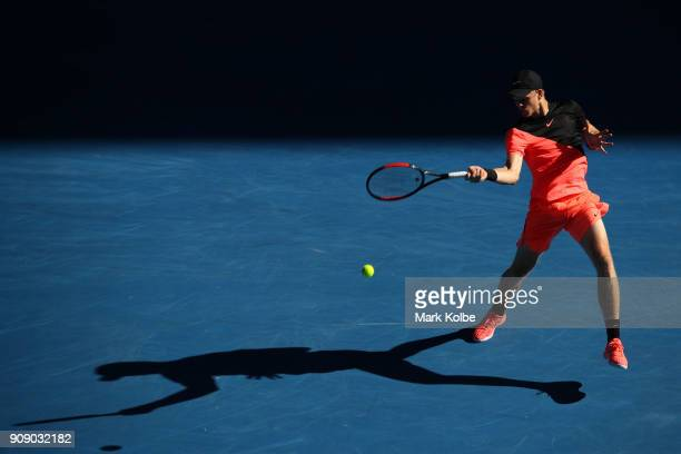 Kyle Edmund of Great Britain plays a forehand in his quarterfinal match against Grigor Dimitrov of Bulgaria on day nine of the 2018 Australian Open...