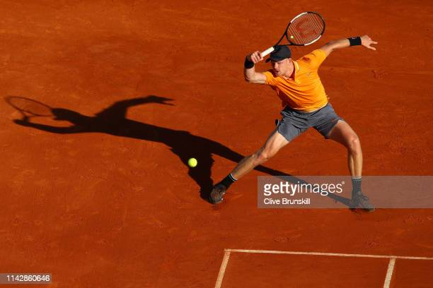 Kyle Edmund of Great Britain plays a forehand in his singles match against Diego Schwartzman of Argentina during day two of the Rolex Monte-Carlo...