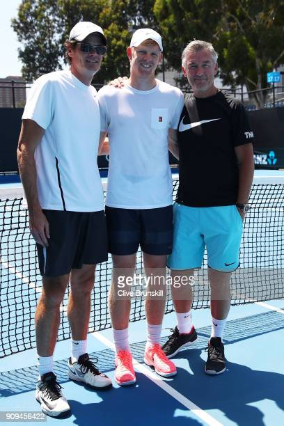 Kyle Edmund of Great Britain poses for a photo with his physical performance coach Ian Prangley and coach Fredrik Rosengren after completing a...