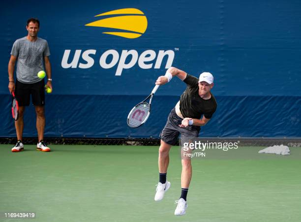 Kyle Edmund of Great Britain practices with his coach, Mark Hilton and physio, Ian Prangley, before the start of the US Open at the USTA Billie Jean...