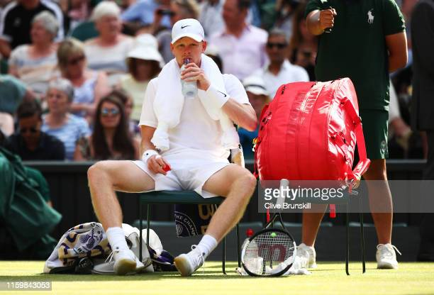 Kyle Edmund of Great Britain rests between changing sides in his Men's Singles second round match against Fernando Verdasco of Spain during Day three...