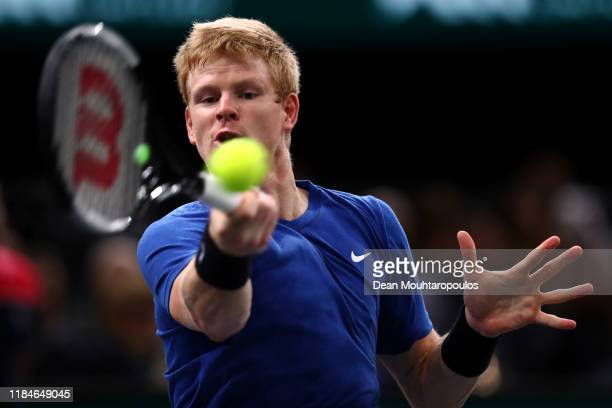 Kyle Edmund of Great Britain returns a forehand in his match against Novak Djokovic of Serbia on day 4 of the Rolex Paris Masters, part of the ATP...