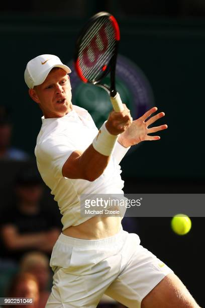 Kyle Edmund of Great Britain returns a shot against Bradley Klahn of the United States during their Men's Singles second round match on day four of...