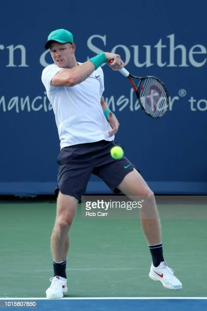 Kyle Edmund of Great Britain returns a shot against Mackenzie McDonald during Day 2 of the Western and Southern Open at the Lindner Family Tennis...
