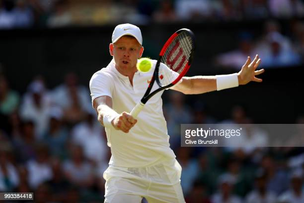 Kyle Edmund of Great Britain returns a shot against Novak Djokovic of Serbia during their Men's Singles third round match on day six of the Wimbledon...