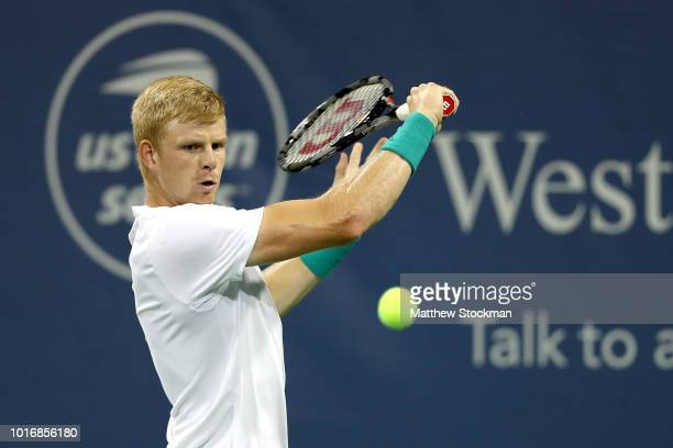 Kyle Edmund of Great Britain returns a shot to Denis Shapovalov of Canada during the Western Southern Open at Lindner Family Tennis Center on August...