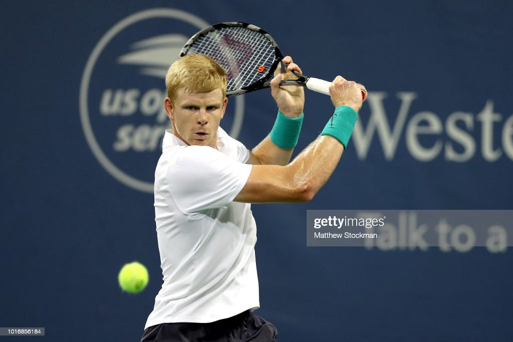 Kyle Edmund of Great Britain returns a shot to Denis Shapovalov of Canada during the Western & Southern Open at Lindner Family Tennis Center on August 14, 2018 in Mason, Ohio.