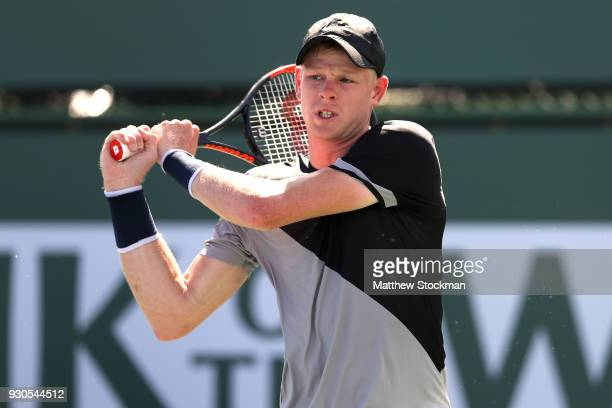 Kyle Edmund of Great Britain returns a shot to Dudi Sela of Israel during the BNP Paribas Open at the Indian Wells Tennis Garden on March 11 2018 in...