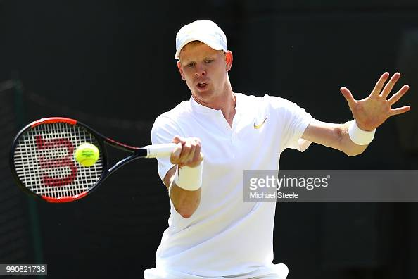 Kyle Edmund of Great Britain returns against Alex Bolt of Australia during their Men's Singles first round match on day two of the Wimbledon Lawn...