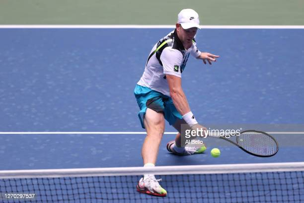 Kyle Edmund of Great Britain returns the ball during his Men's Singles second round match against Novak Djokovic of Serbia on Day Three of the 2020...