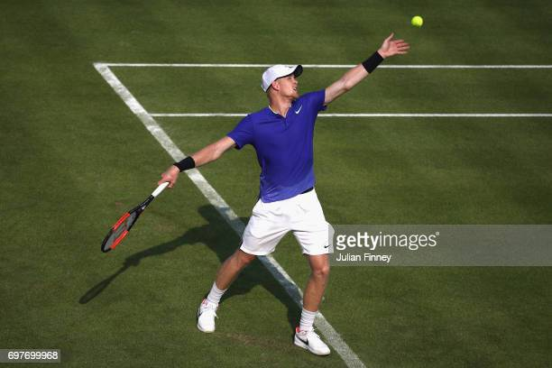 Kyle Edmund of Great Britain serves during the mens singles first round match against Denis Shapovalov of Canada during day one of the 2017 Aegon...