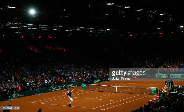 Kyle Edmund of Great Britain serves during the singles match against David Goffin of Belgium on day one of the Davis Cup Final 2015 at Flanders Expo...