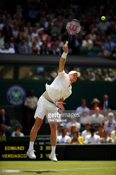 Kyle Edmund of Great Britain serves in his Men's Singles second round match against Fernando Verdasco of Spain during Day three of The Championships...