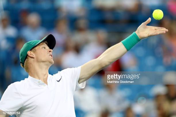 Kyle Edmund of Great Britain serves to MacKenzie McDonald during the Western Southern Open at Lindner Family Tennis Center on August 12 2018 in Mason...
