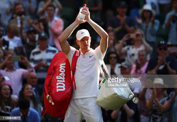 Kyle Edmund of Great Britain shows appreciation to the fans following his defeat in his Men's Singles second round match against Fernando Verdasco of...