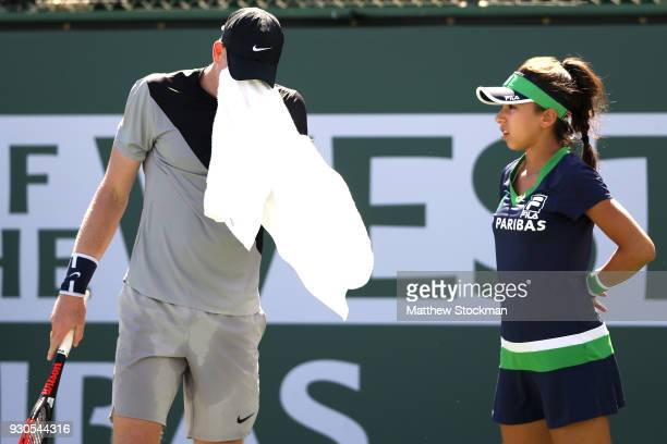 Kyle Edmund of Great Britain towels off between points while playing Dudi Sela of Israel during the BNP Paribas Open at the Indian Wells Tennis...