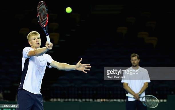 Kyle Edmund of Great Britain watched closely by his team captain Leon Smith during a practice session prior to the Davis Cup World Group semi final...