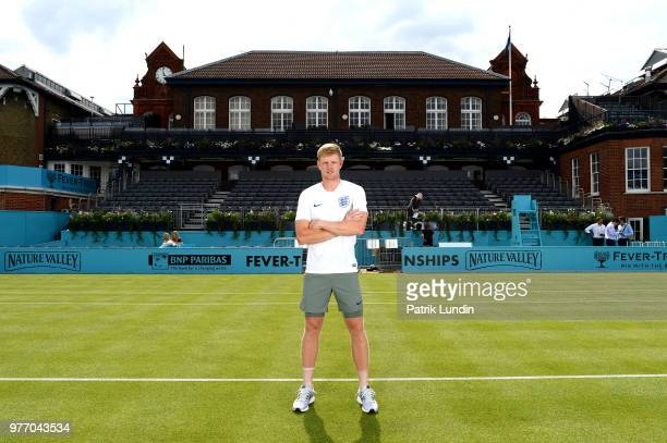 Kyle Edmund of Great Britain wearing an England shirt in support of the World Cup team during qualifying Day 2 of the FeverTree Championships at...