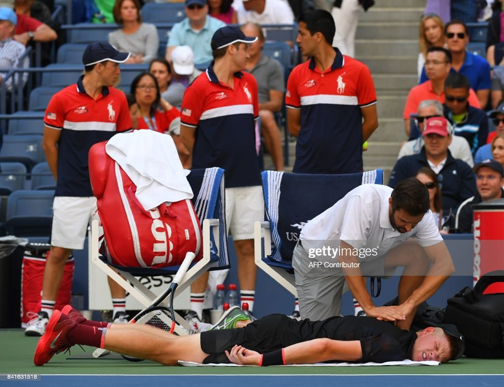 Kyle Edmund of Great Britian receives a back adjustment from a trainer during his match against Denis Shapovalov of Canada during their US Open 2017 3rd Round Men's Singles match at the USTA Billie Jean King National Tennis Center on September 1, 2017 in New York. /