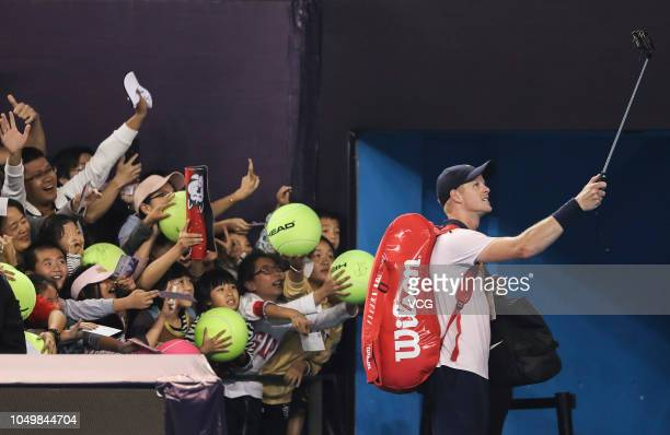 Kyle Edmund of the Great Britain takes a selfie with fans after winning the Men's Singles Quarter-final match against Dusan Lajovic of Serbia on day...