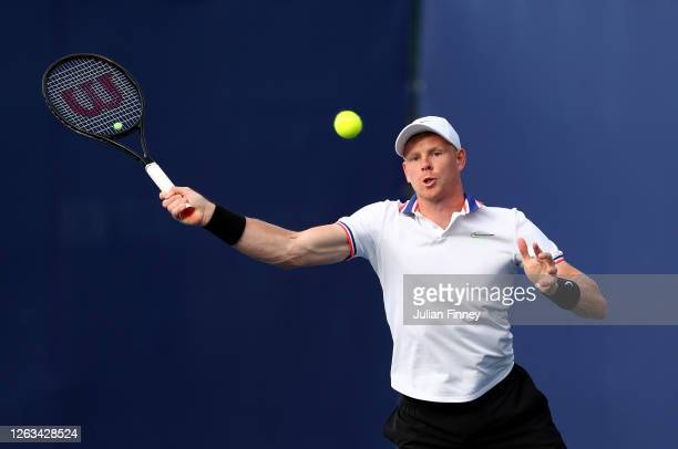 Kyle Edmund partner of Emma Raducanu of British Bulldogs plays a forehand in their mixed doubles match against Andy Murray and Naomi Broady of Union...
