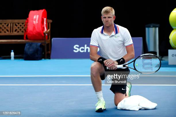 Kyle Edmund takes a knee, in solidarity with the BLM movement, before the start of his match against James Ward on day 1 of Schroders Battle of the...