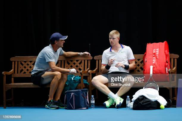 Kyle Edmund talks to his coach Colin Beecher at the change of ends during his singles semi final match against Cameron Norrie on day 5 of Schroders...