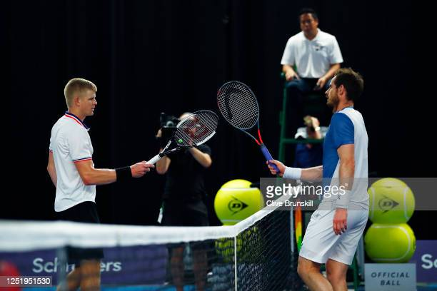 Kyle Edmund touches racquets with Andy Murray after winning their singles match on day 2 of Schroders Battle of the Brits at the National Tennis...