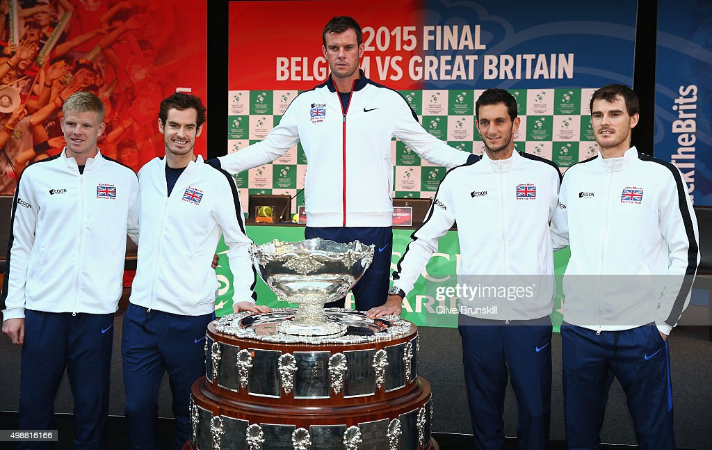 Kyle Edmund,Andy Murray,team captain Leon Smith,James Ward and Jamie Murray of Great Britain pose for a photograph with the Davis Cup trophy after the draw ceremony ahead of the start of the Davis Cup Final at Flanders Expo on November 26, 2015 in Ghent, Belgium.