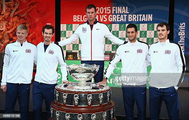 Kyle EdmundAndy Murrayteam captain Leon SmithJames Ward and Jamie Murray of Great Britain pose for a photograph with the Davis Cup trophy after the...
