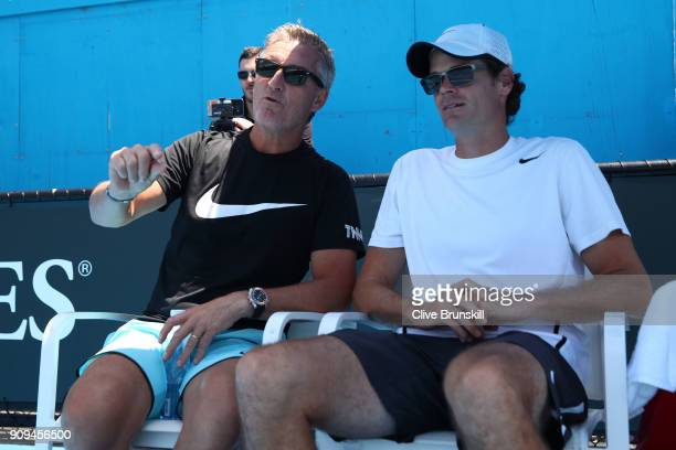 Kyle Edmund's coach Fredrik Rosengren and physical performance coach Ian Prangley watch Edmund during a practice session on day 10 of the 2018...