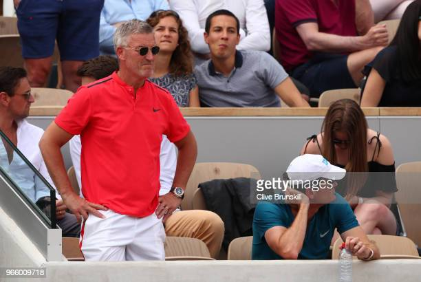Kyle Edmund's coach Fredrik Rosengren watches on as he faces Fabio Fognini of Italy in the mens singles third round match during day seven of the...
