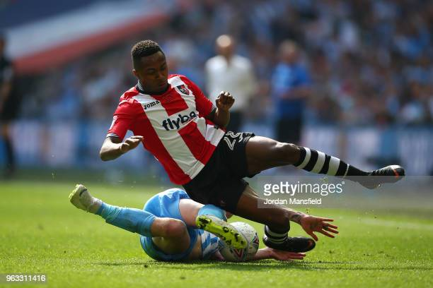 Kyle Edwards of Exeter City and Jack Grimmer of Coventry City in action during the Sky Bet League Two Play Off Final between Coventry City and Exeter...