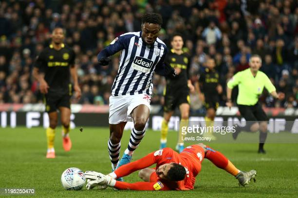 Kyle Edwards of West Bromwich Albion has his run towards goal intercepted by David Raya of Brentford during the Sky Bet Championship match between...