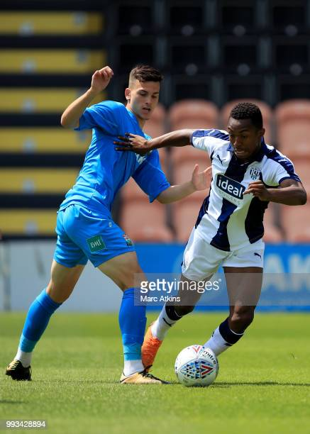 Kyle Edwards of West Bromwich Albion in action with Roy Syla of Barnet during the Preseason friendly between Barnet and West Bromwich Albion on July...