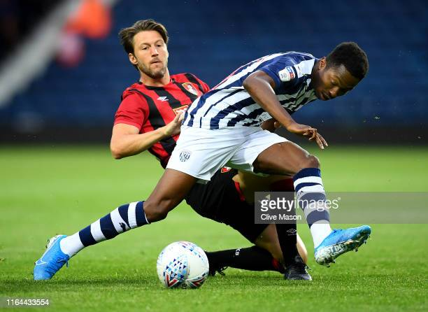 Kyle Edwards of West Bromwich Albion is challenged by Harry Arter of Bournemouth during the PreSeason Friendly match between West Bromwich Albion and...