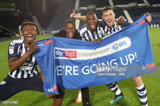 Kyle Edwards Rayhaan Tulloch Rekeem Harper and Dara O'Shea of West Bromwich Albion celebrate promotion to the Premier League on the pitch at the end...